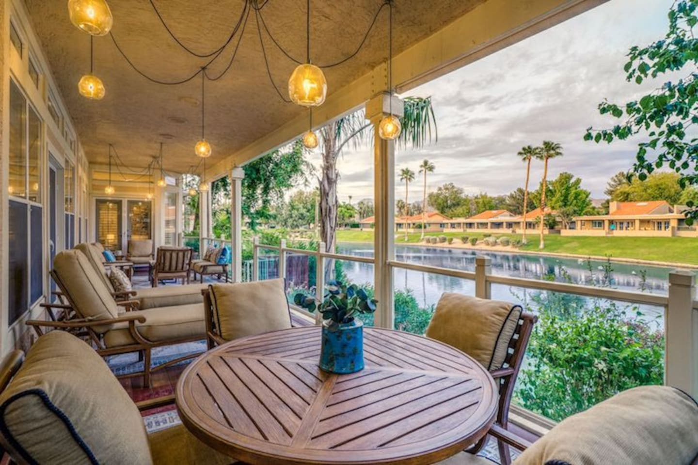 Amazing Patio overlooking the lake.  Lounge chairs and dining table for evening dinner or morning coffee.