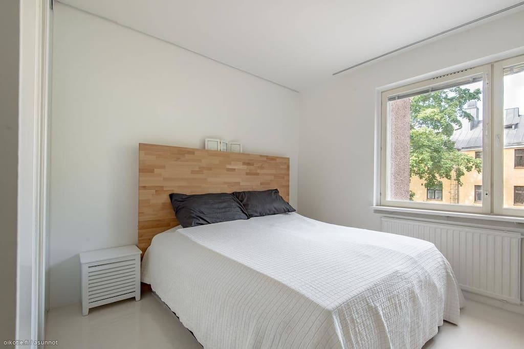 Spacious bedroom with large king size bed and flatscreen TV.