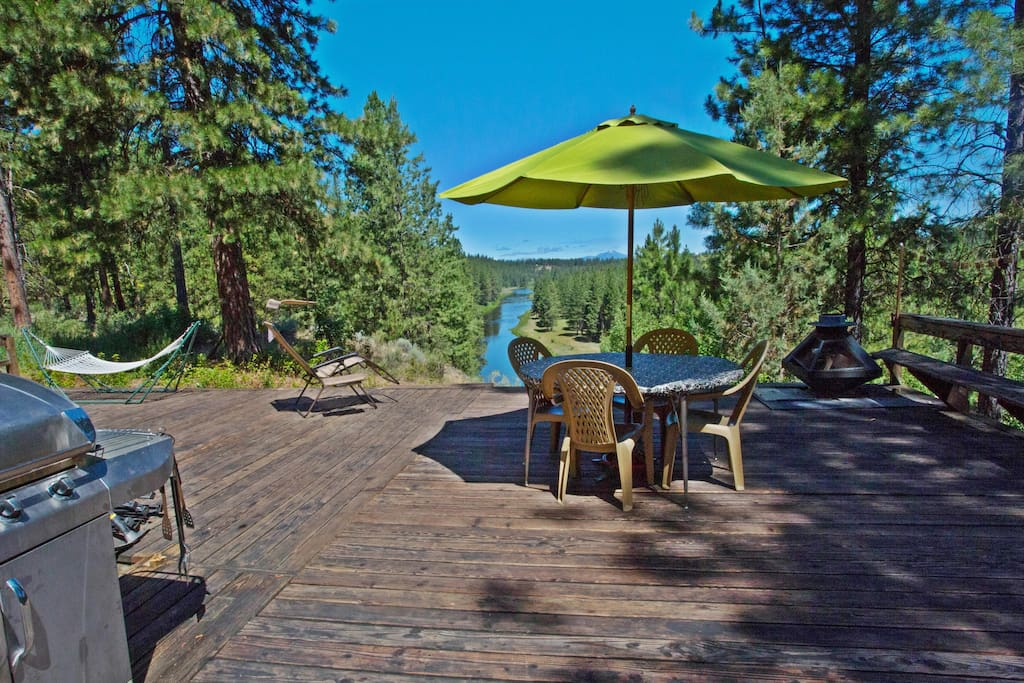 Back part of deck: BBQ, 1 of the hammocks, lounge chair, table & fire pit in far corner