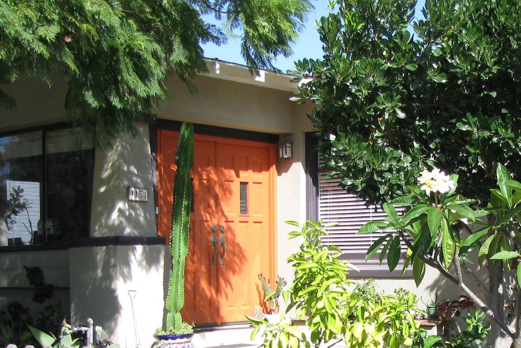 You'll know you've arrived at the right address when you are greeted by the cheerful, orange front door.