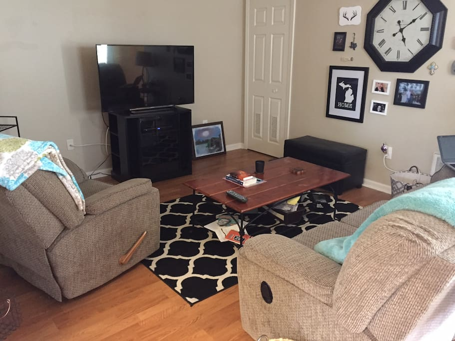 Living room with cable TV and reclining couch