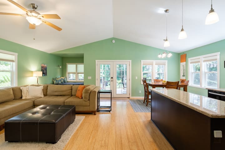 The spacious main living area is open-concept with windows on all sides for lots of natural light.