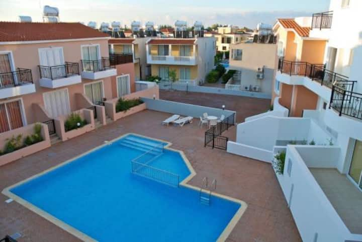 2 Bed Apartment with private garden by the pool