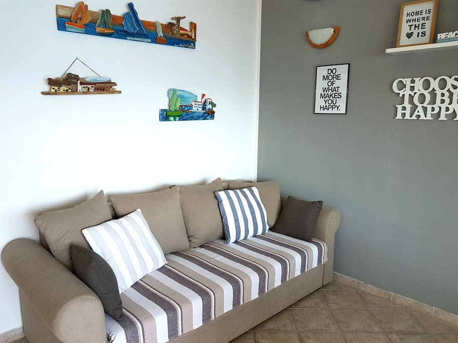 Sofa in living room (can be turned into bed 1.5 m wide)