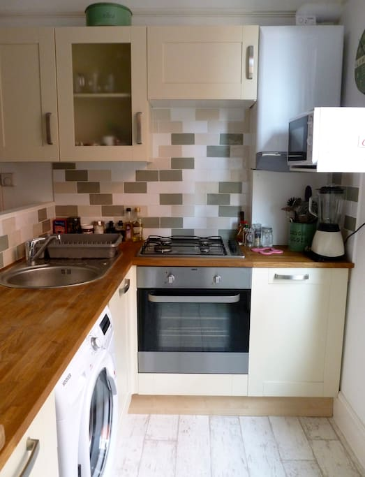 Cosy kitchen for you to cook or do your washing (equipment and cleaning stuff provided)