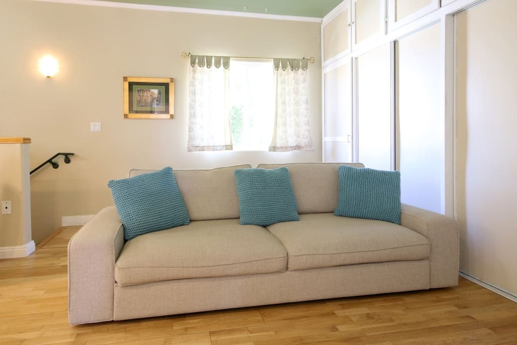 Large (96-inch) Ikea couch that opens up to a comfortable full-size, bed.