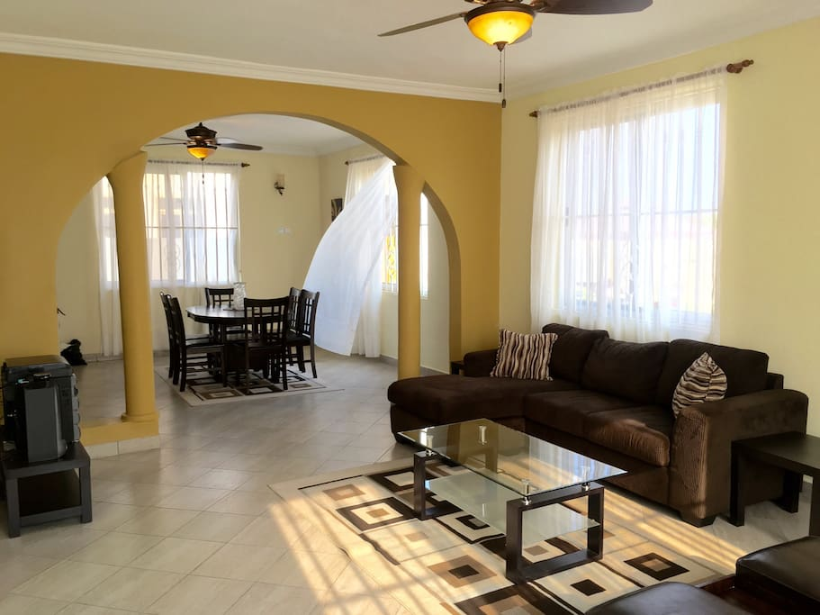 Beautifully set up living and dining rooms with AC, digital tv, music system, buffet table, just to mention a few.