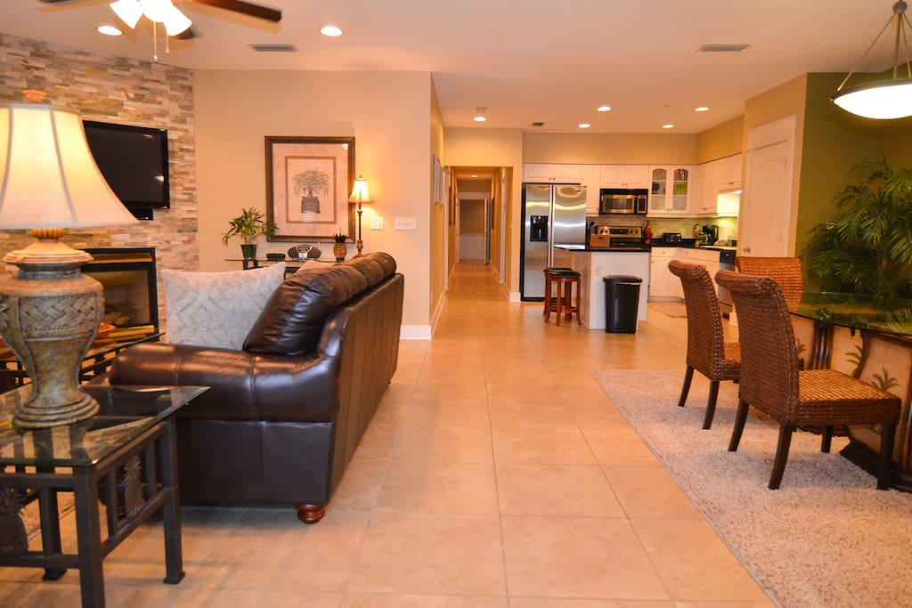 Open concept living, dining and kitchen areas