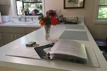 Guest book with information and instructions, gate opener and house key.