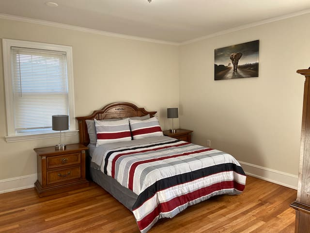 """Bedroom #2 is on the 2nd Floor. It has a full bed, a closet, two windows, and a 35"""" Smart TV"""