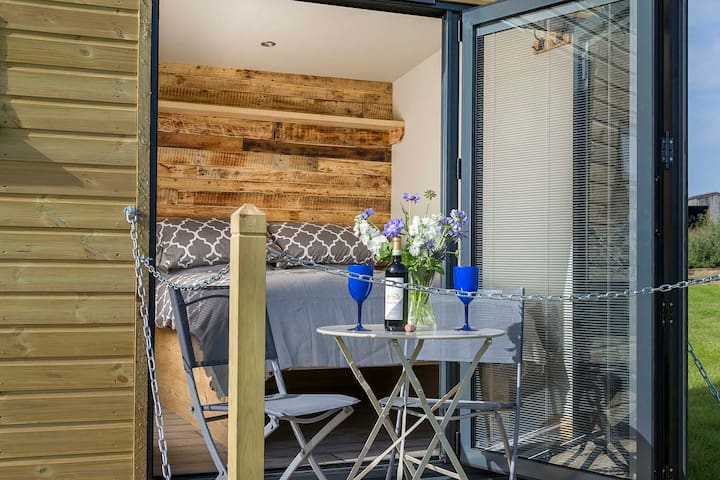 Bifold doors from the cosy bedroom