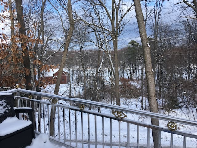 A snowy view of the Winooski River in the distance.