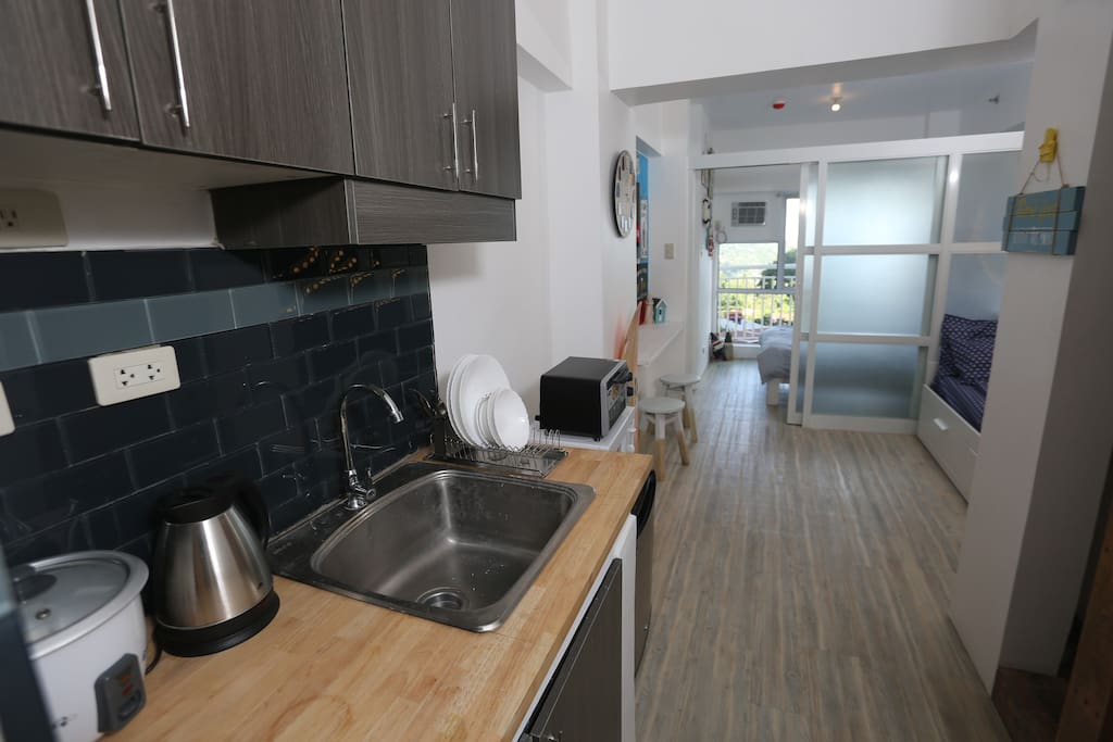 1 BR unit complete with dining area, kitchen, day bed that turns to a queen size bed at night.