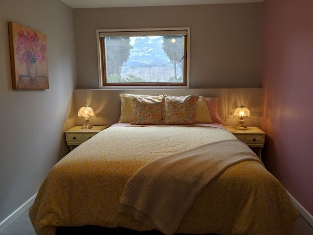 The Pink room features a queen sized bed