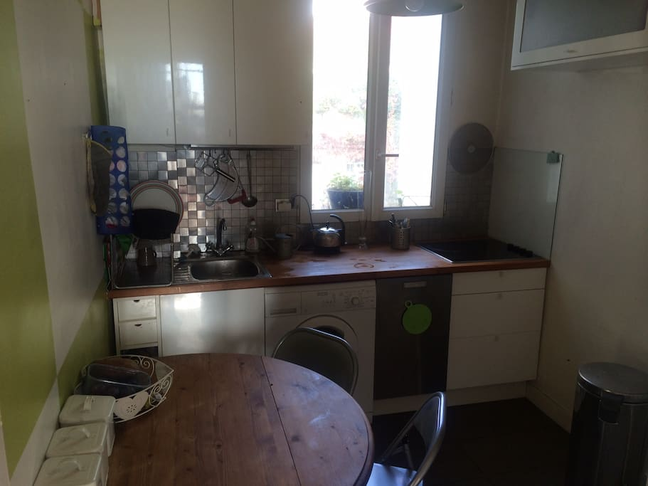 Kitchen area with washing machine & dish washer- 4 hob electric stove, oven, microwave fridge & freezer