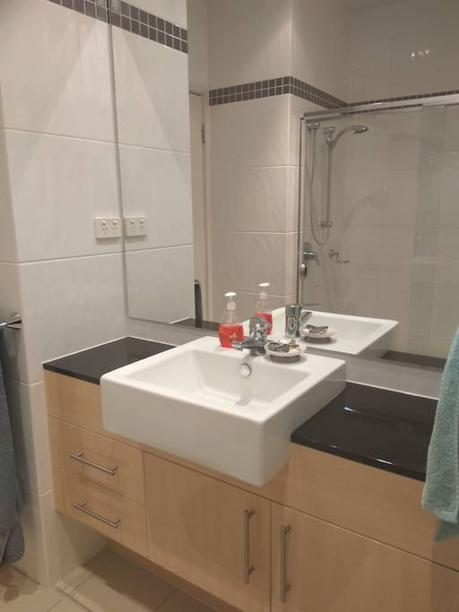 En suite bathroom with enormous shower and separate toilet.