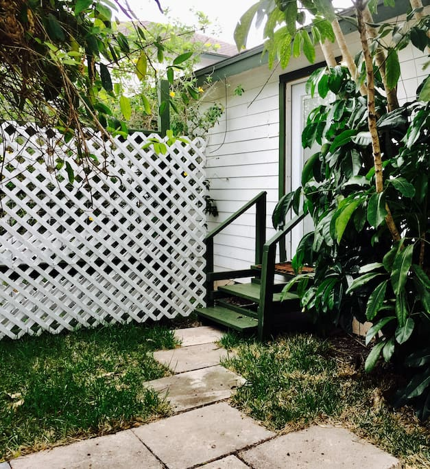 Private entrance in safe neighborhood with fenced yard.