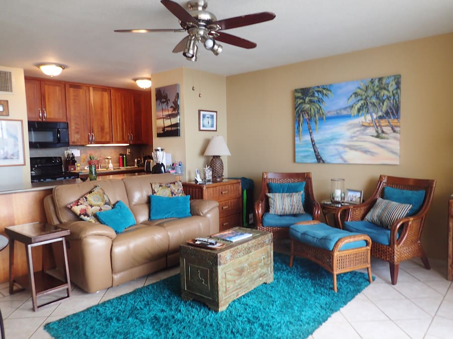 living room, kitchen, dining table and chairs for eating ndoors or working next to large screen TV,