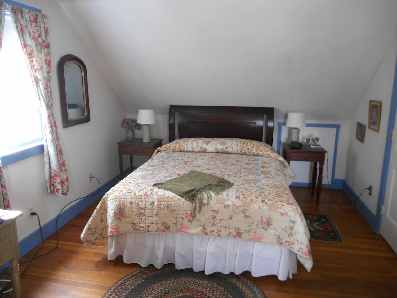 Queen size bed in large room