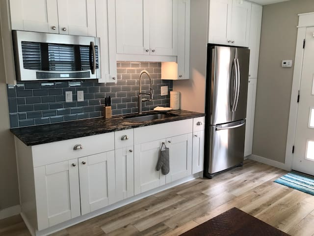 Kitchen with Microwave / Convention Oven combo.