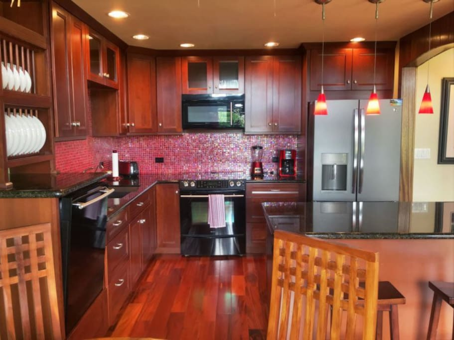 The kitchen features Jenn-Aire appliances and gorgeous cherrywood cabinetry.