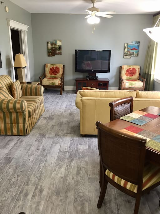 """Living room with queen sleeper sofa and 50"""" flat screen TV"""
