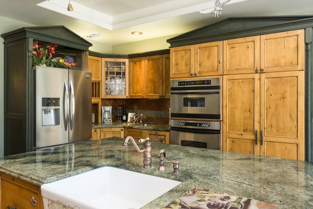 The gourmet kitchen has polished granite countertops.