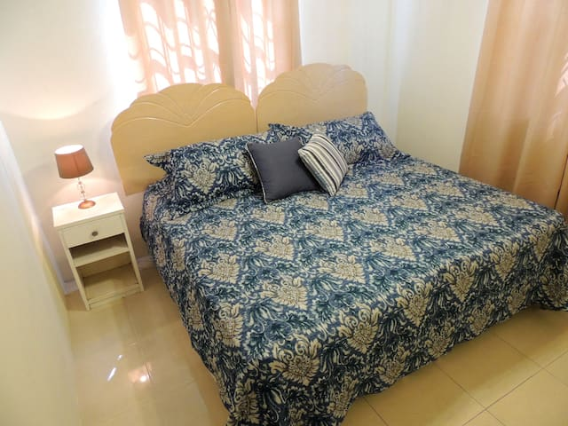 (2nd) Bedroom located on the right as you enter the apartment - made up as King sized bed (can be split into (2) single beds) A/C, ceiling fan, built in closet, side table & lamp.