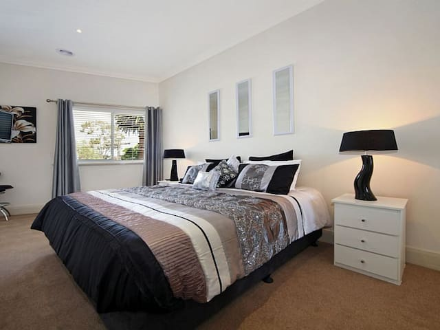 Our master suite has a super comfortable King bed or if it suits your group we can provide 2x single beds instead! Also features built-in wardrobes (not pictured) for extra luggage space.