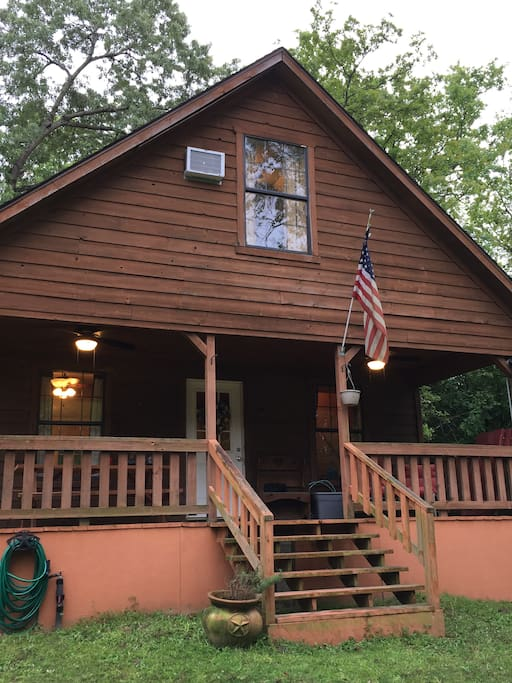 The cabin is 2 stories and approximately 1100 square feet. It has an outdoor swing set for the kids and is located next to a catfish pond.