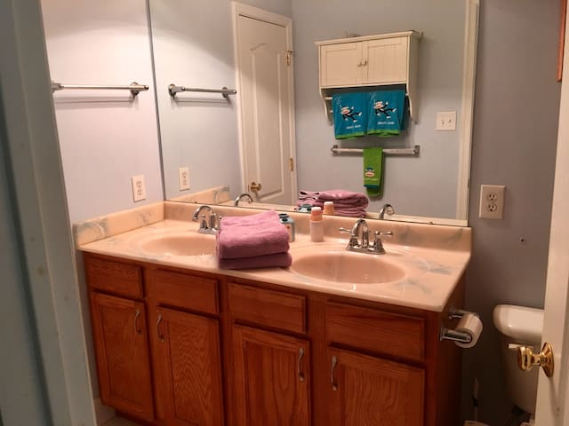 Shared bath with double sinks, tub and shower