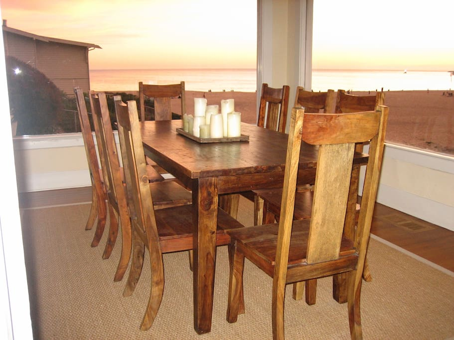 dining room with expansive views of beach and pier