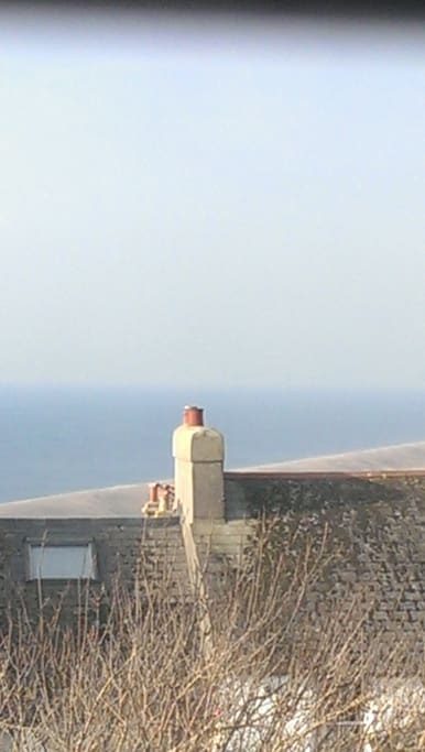View to the left from the top floor overlooking Chesil Beach out towards Devon.