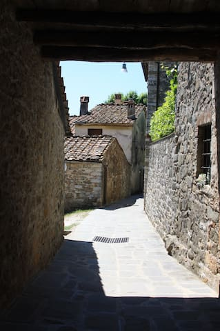 a characteristic walk along the quiet path from the piazza to the house
