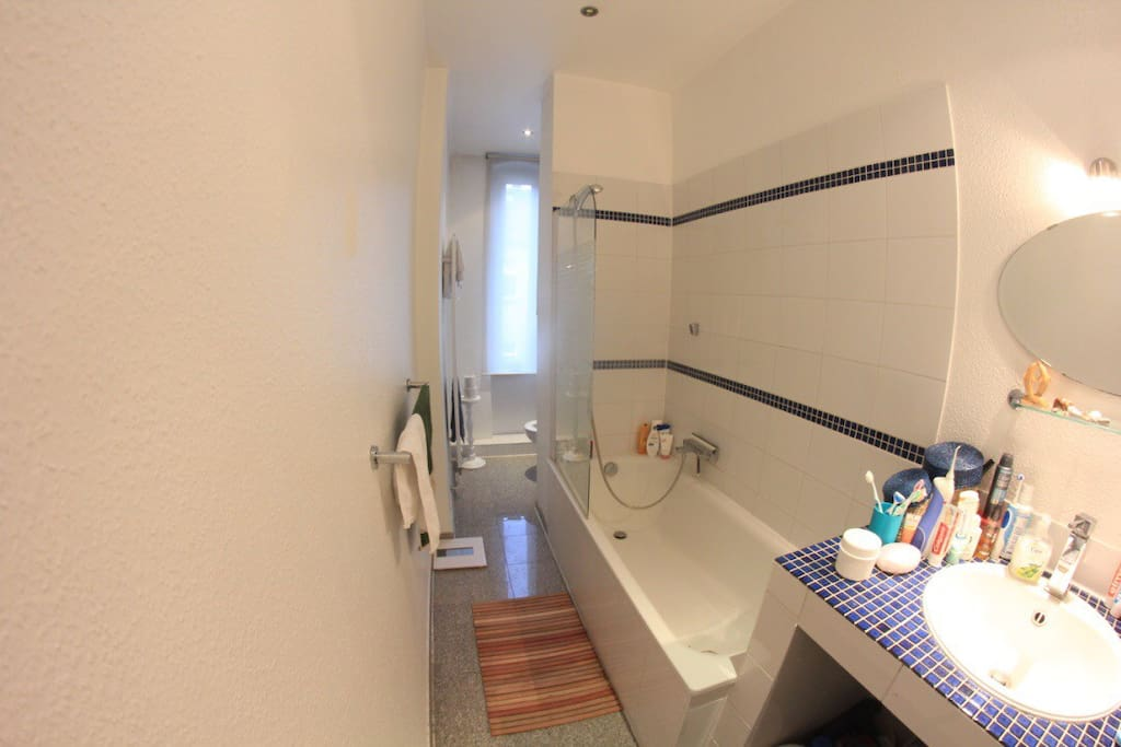 The bathroom with bathtub and window.
