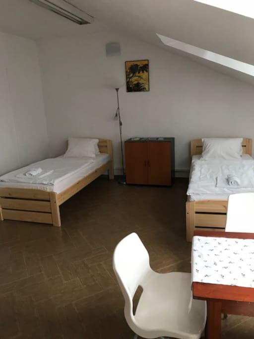 Two single beds, table, chairs, wardrobe