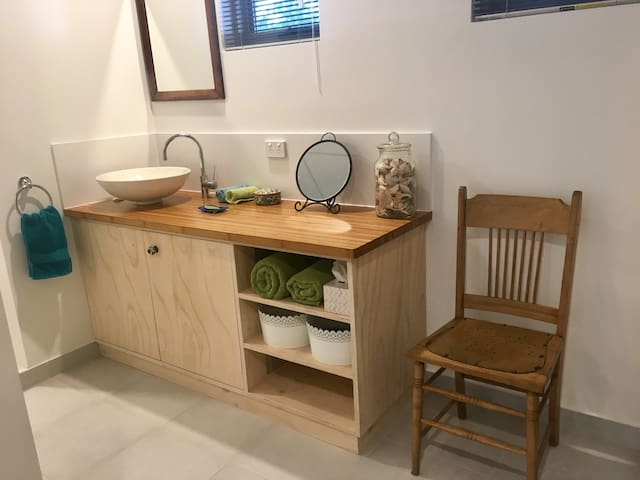 Handcrafted ply bathroom cabinets .