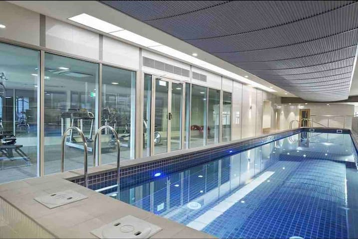city private room 55 inch TV free gym pool