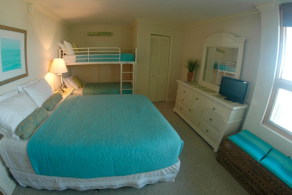 Bedroom with Queen bed and twin bunk beds