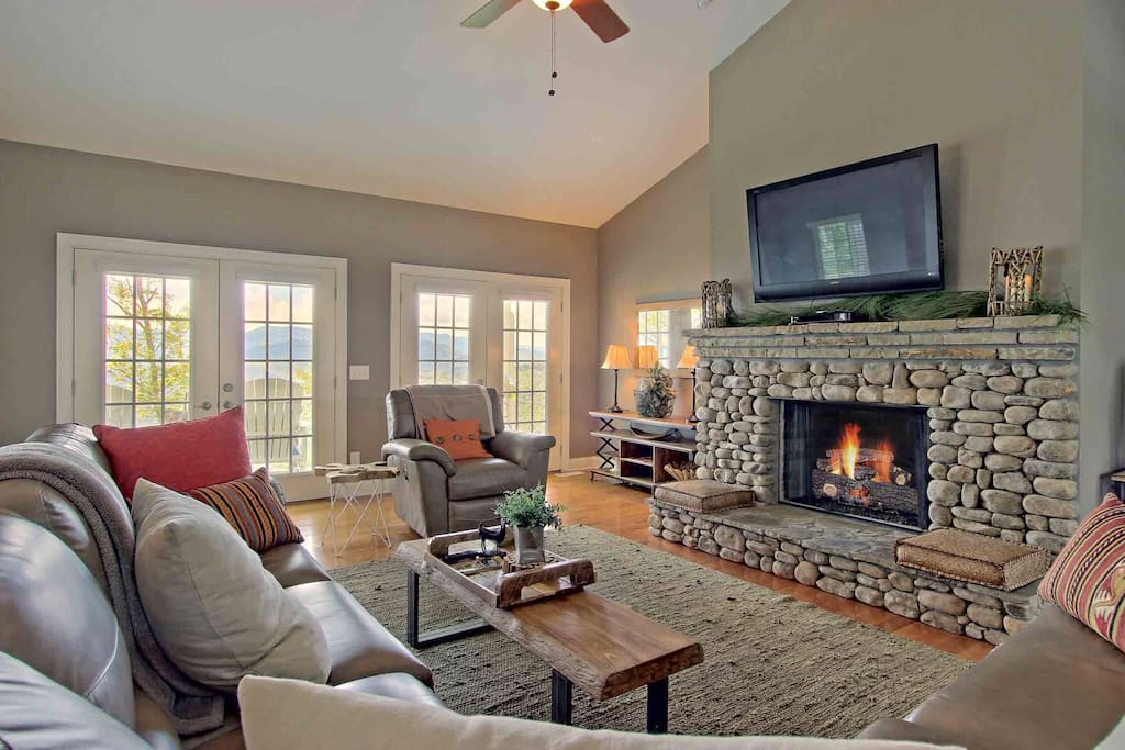 Snuggle up in front of the gas fireplace and enjoy the view.  The chair is a recliner and there is another recliner in the sectional sofa.