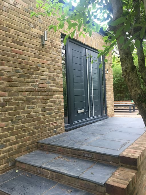 Double doors to front porch area, private patio around, lovely garden planted to the front, 20 ft up and 50 ft back from the quiet road, views into withdean woods, completely private and not overlooked.