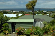 View from backyard overlooking our garden shed and water tanks.
