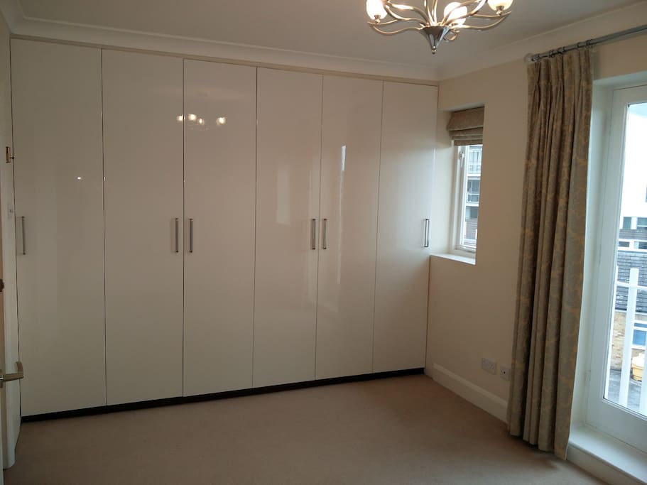 En-suite master bedroom with enormous fitted wadrobe