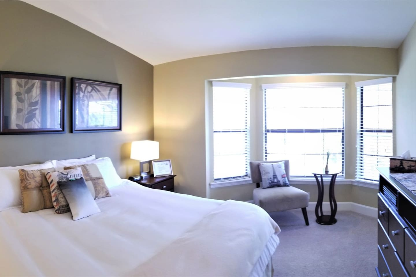 A spacious master bedroom for your leisure.