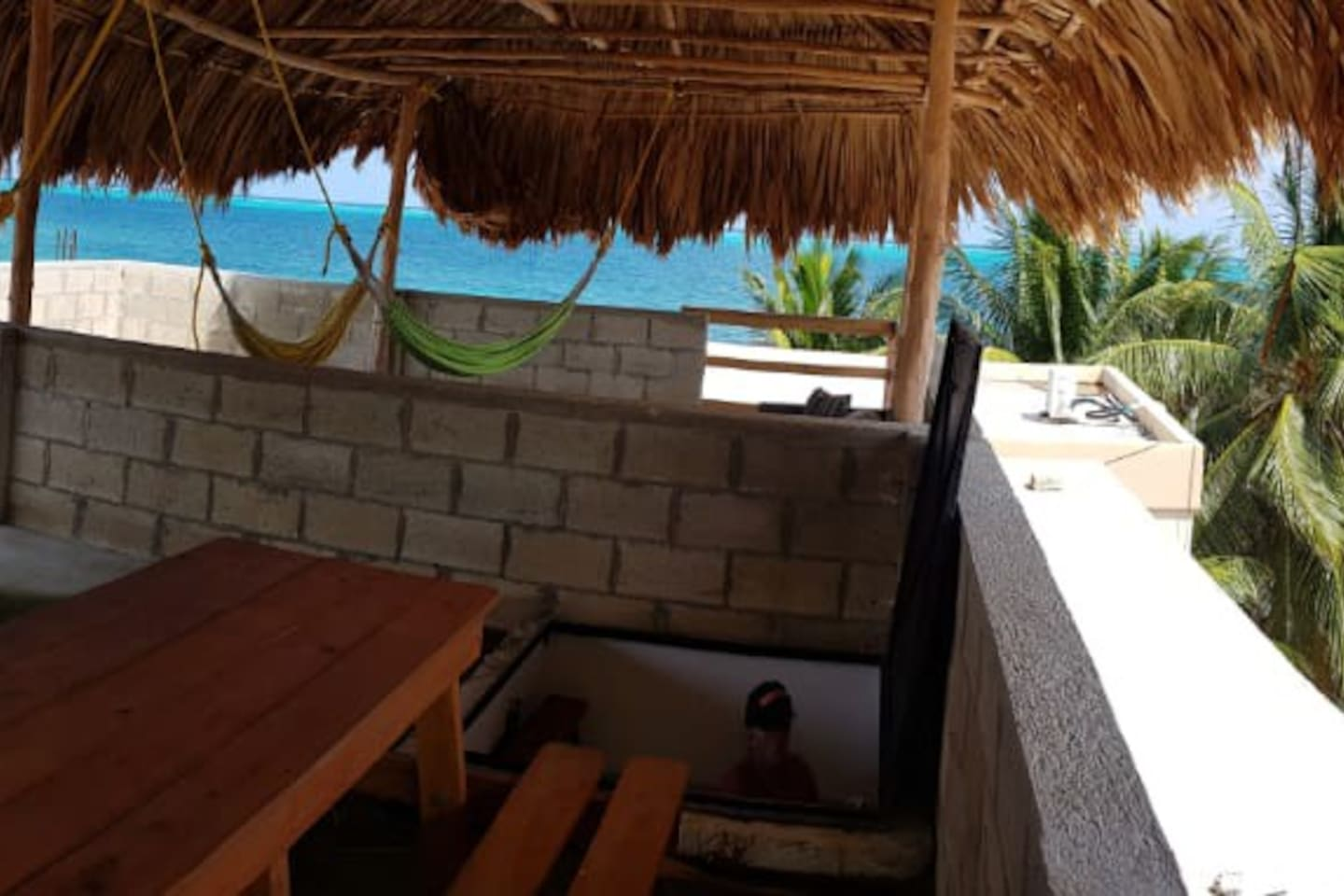 My condo has rooftop deck with palapa, hammocks, picnic table and amazing views!