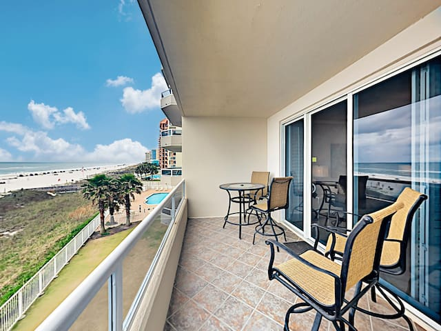 Dine alfresco on the covered balcony, furnished with a bistro table and seating for 4.