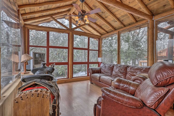 With beds for 8, this spacious home is surrounded by towering pine trees.