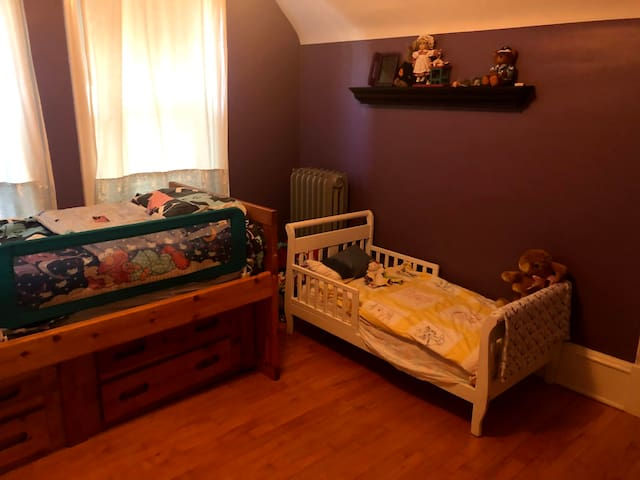 Second Bedroom with a double bed and toddler's bed.