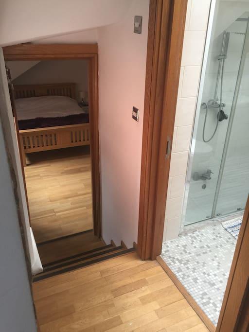 Bathroom not ensuite but right outside bedroom door .