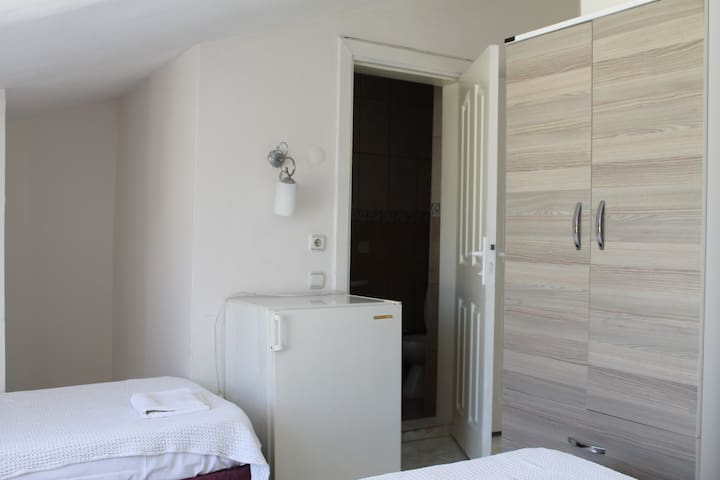 Boutique Hotel Room with 3 single beds